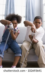African American sister and brother playing video games
