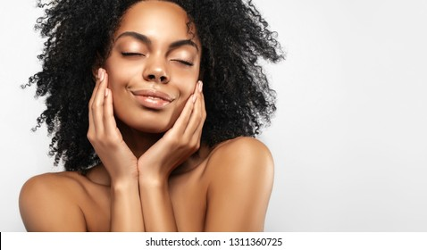 African American skincare models with perfect skin and curly hair. Beauty spa treatment concept. Web banner with copy space