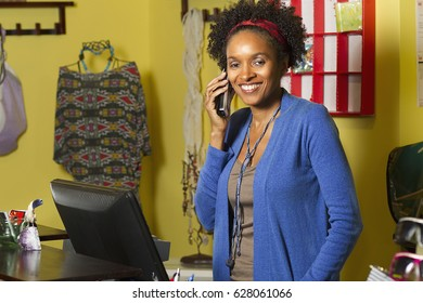 African American small business owner in clothing shop