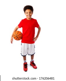African American smiling teenager, basketball player posing with a ball in his hand isolated on white background. Full body portrait.