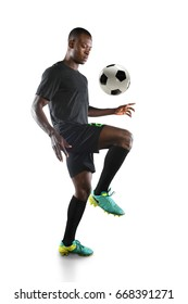 African American soccer player bouncing ball on knee isolated over white background