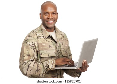 African American soldier smiles while typing a computer
