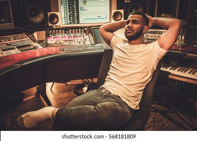 African american sound engineer in boutique recording studio.