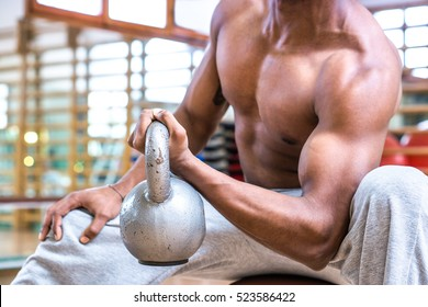 African american sports man body builder lifting heavy weight dumbbell at gym fitness center close up image of biceps training - Powerful attractive black guy exercising arms - Focus on ball handle
