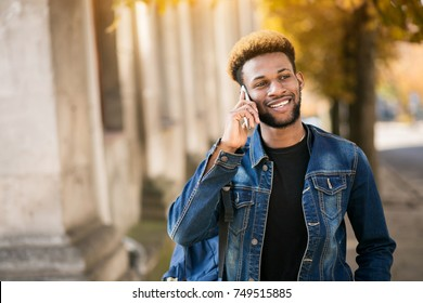 African american student with phone