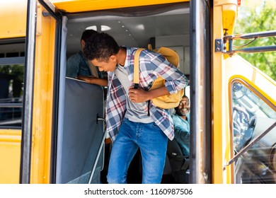 african american student walking out of school bus