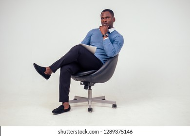 african american stylish business man at the workspace office on white background in studio shot