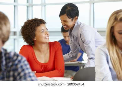 African American teacher helping student in class