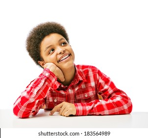 African American teenager dreaming, looking up, thinking. Isolated, over white background, with copy space