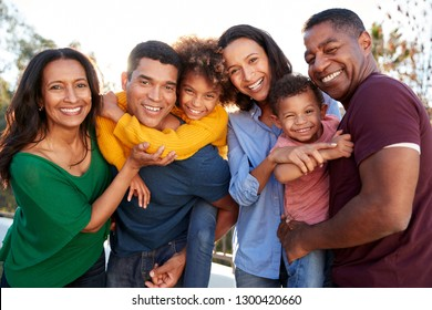 African American three generation family playing together in the garden, smiling to camera
