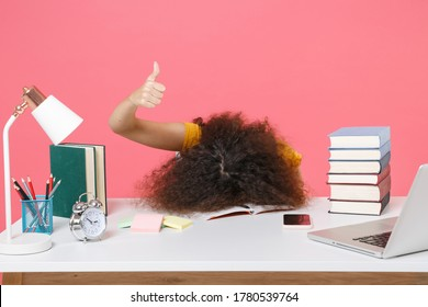 African american tired student women employee in office sit work at desk isolated on pink background. business career Education in school university college concept. Put head on table showing thumb up