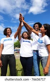African american volunteer group giving high five