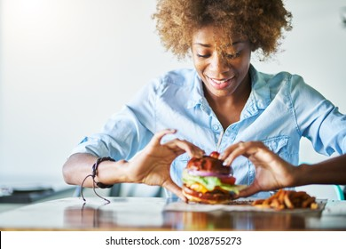african american woman about to eat meatless vegan burger