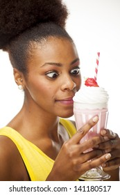 African American woman about to enjoy a strawberry milkshake
