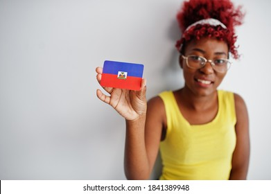 African american woman with afro hair, wear yellow singlet and eyeglasses, hold Haiti flag isolated on white background.