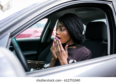 african american woman in car