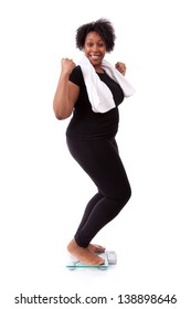 African American woman cheering on scale isolated over white background - African people
