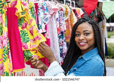 African american woman with colorful clothes outdoors at typical traditional market