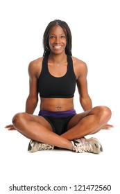African American woman dressed in workout clothing sitting over white background