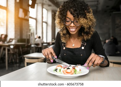 african american woman eating