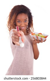 African American woman eating salad, isolated on white background