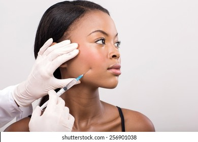 african american woman face lifting on her cheek