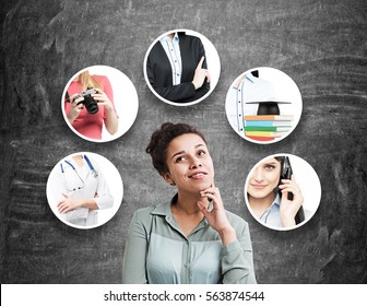 African American woman in a gray shirt is standing near a blackboard. There are five career choices around her.