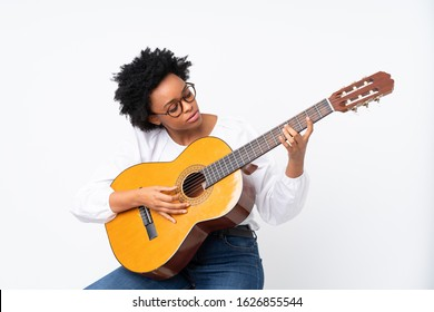African american woman with guitar over isolated background