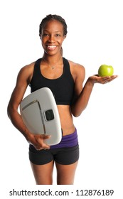 African American woman holding apple and scale isolated over white background