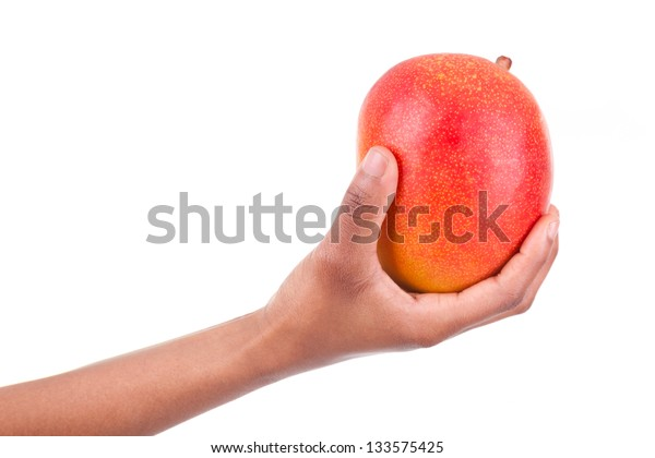 African American woman holding a fresh Mango in her hand,isolated on white background