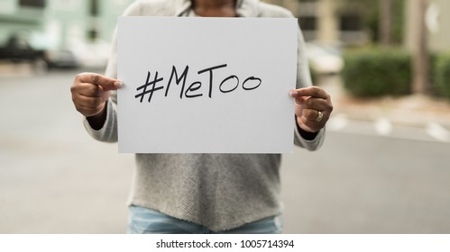 African American Woman holding a Sign with #MeToo
