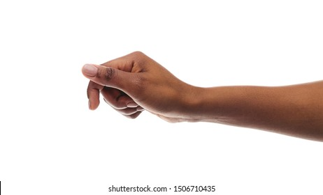 African american woman holding something in fist, ready to share, isolated on white background. Panorana with copy space
