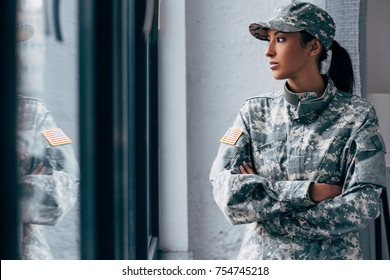 african american woman in military uniform with usa flag emblem