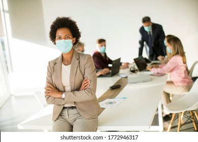 African American woman in the office wear mask as protection from corona virus