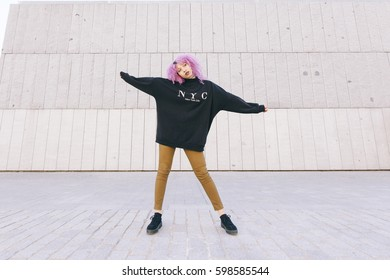 african american woman with purple afro hair and a egocentric New York sweater.
