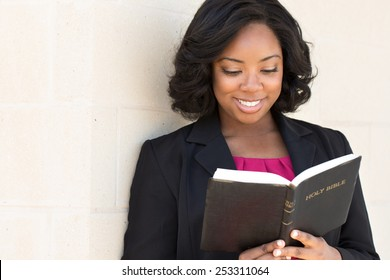 African American woman reading The Bible