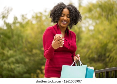 African American woman shopping and texting.