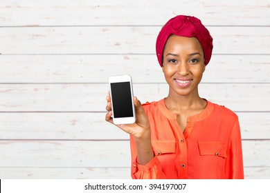 African american woman showing smartphone