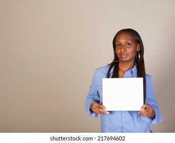 African American woman with some American Indian heritage holding a sign with room for copy space