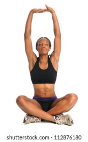African American woman stretching in sitting position isolated over white background