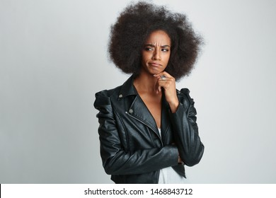 African american Woman thinking with finger on her chin