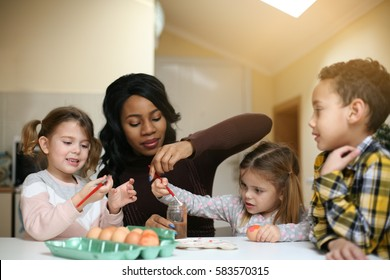 African American woman with three child prepare for Easter.