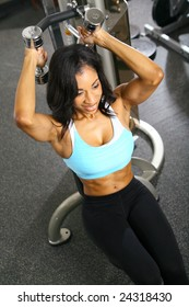 african american woman training or exercising in gym, weight lifting for tricep