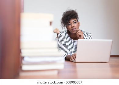 African American woman using a laptop in her living room