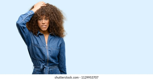 African american woman wearing blue jumpsuit terrified and nervous expressing anxiety and panic gesture, overwhelmed