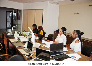 African american women colleagues, crew of divercity female partners in office sit at the table.