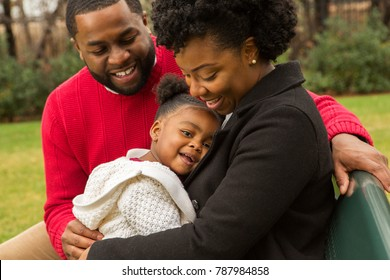 African American young family with their little girl.