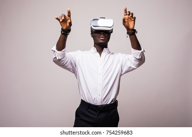 African American young man wearing vr virtual reality headset over white