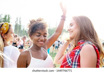African American young woman with friends at summer music festival