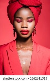 african american young woman in stylish outfit and turban with closed eyes isolated on red - Shutterstock ID 1862611315